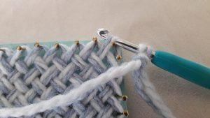 Crochet hook through the corner loop
