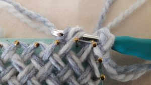 Yarn over the crochet hook