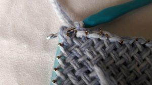 Make first stitch in corner C