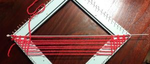 Using a thin knitting needle: weaving