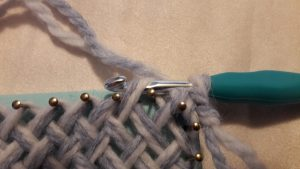 Crochet hook through 2nd sideloop