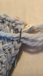 Needle back into last stitch