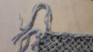 Yarn cut and pulled through last stitch
